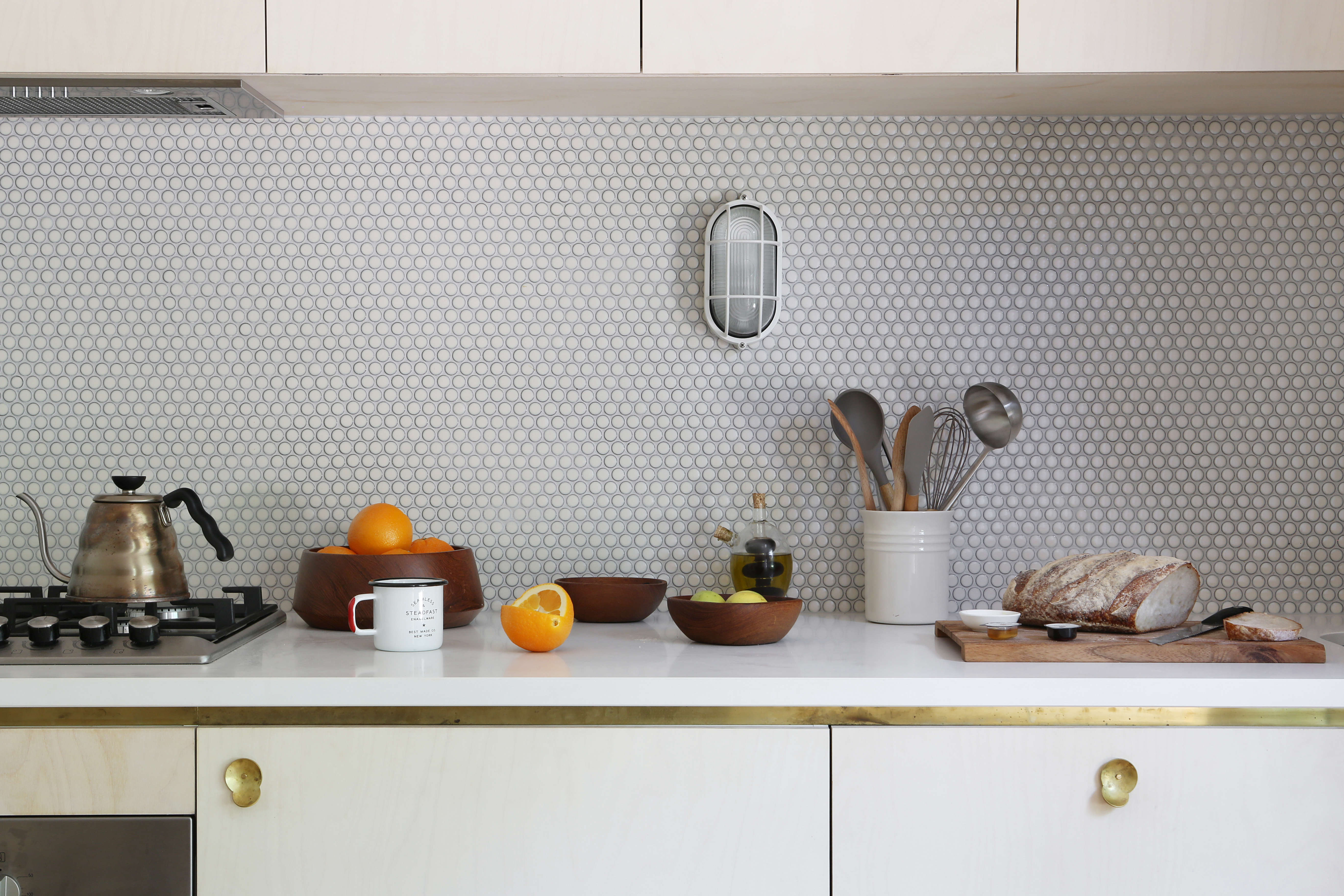 The white tiled kitchen at Jackie Winter Gardens, a guesthouse and artist residency outside Melbourne, Australia, designed by Searah Trotter of Hearth; Rhiannon Taylor photo| Remodelista