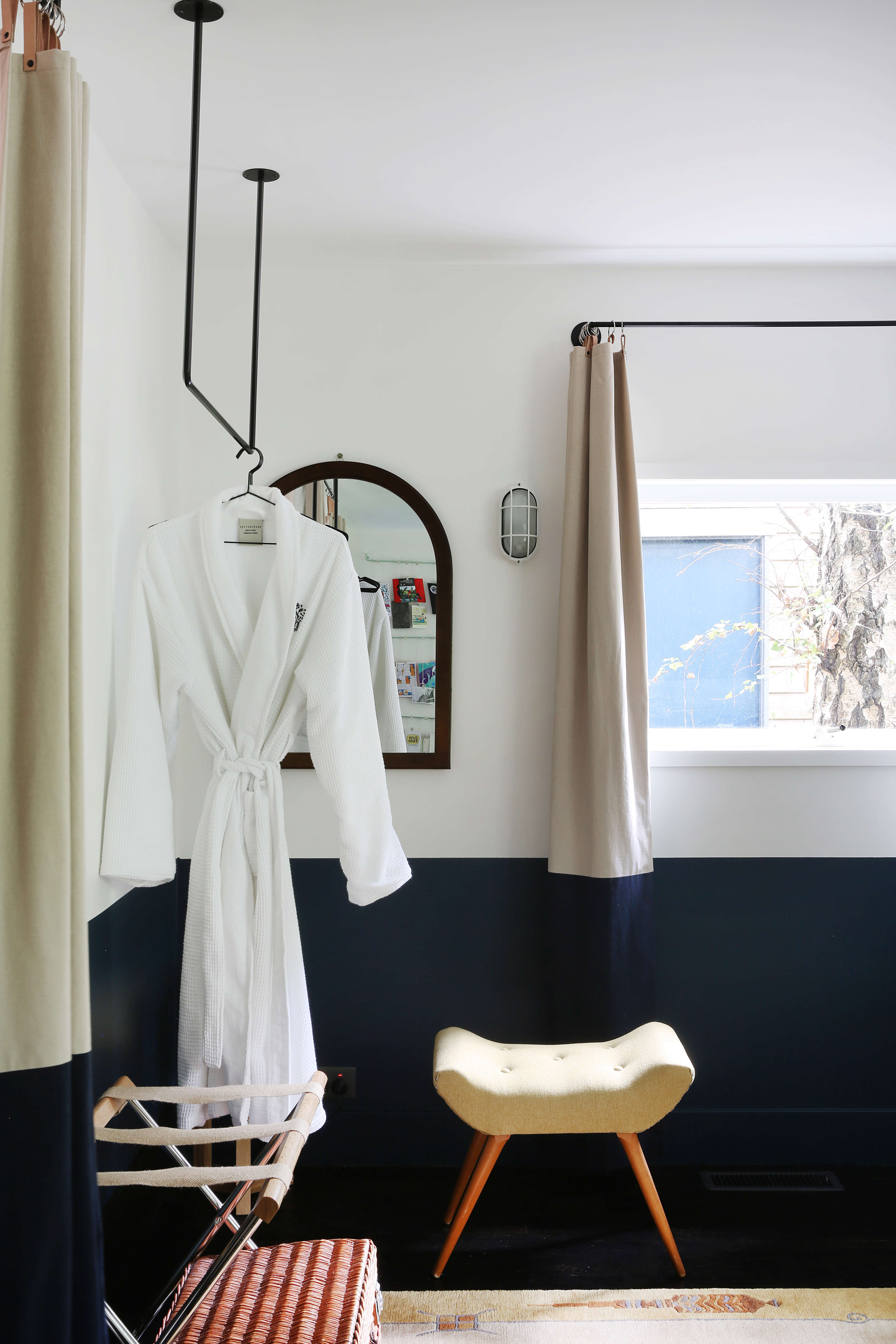 Bedroom with hanging clothes rod at Jackie Winter Gardens, a guesthouse and artist residency outside Melbourne, Australia, designed by Searah Trotter of Hearth; Rhiannon Taylor photo| Remodelista
