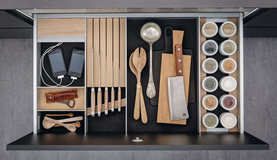 This highly organized kitchen drawer, courtesy of German company SieMatic, includes an area for charging small electronics.Photograph courtesy ofSieMatic, fromKitchen of the Week: A Kitchen Modeled After a Sideboard.