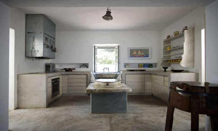 A concrete U-shaped kitchen designed by architect Theodore Zoumboulakis's own retreat on the Greek isle of Hydra. For more, see our post Kitchen of the Week: A Greek Architect's Ode to Minimalism.