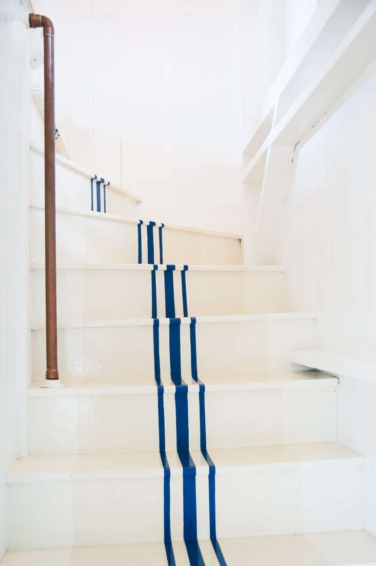A stair runner alternative, on the cheap. For more, see Remodeling 101: Nautical Stripes on the Stairs.
