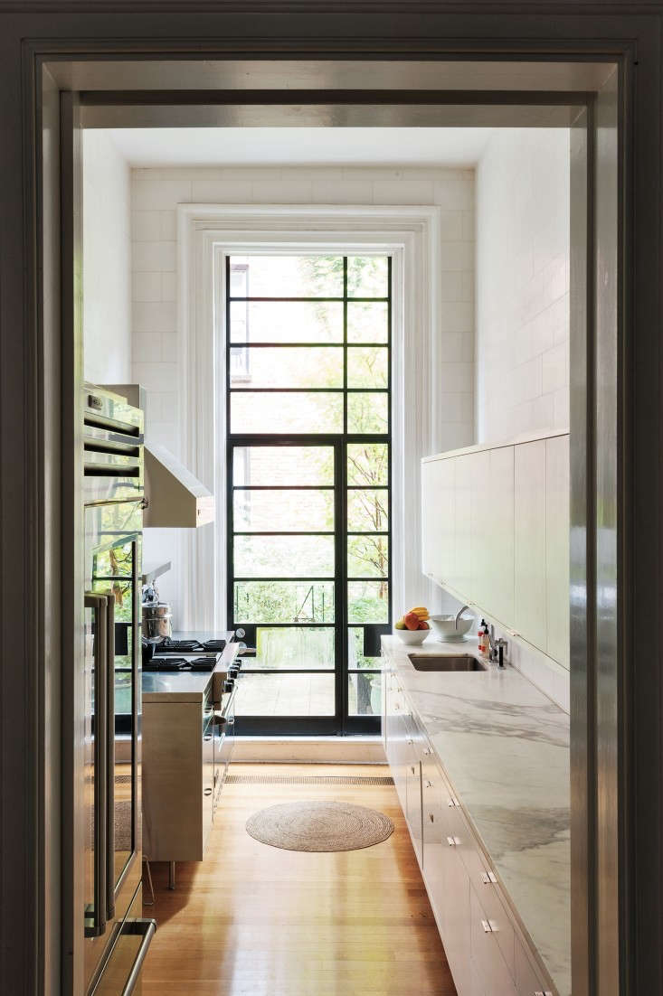 Statuary marble countertops in Francesca's Brooklyn Heights kitchen demonstrate this stone's bright white background and contrasting veining. Photograph by Matthew Williams for Remodelista.