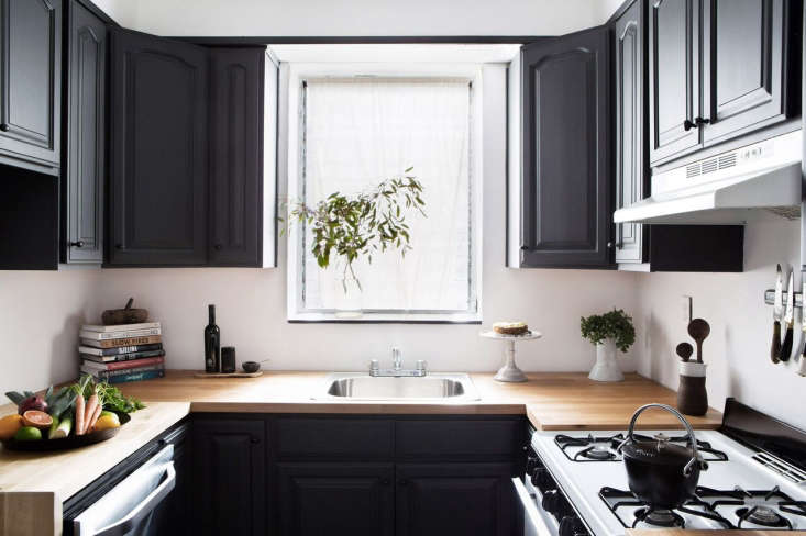 Designer Athena Calderone updated the brown laminate countertops in her rental kitchen with Karlby birch countertops from Ikea. Photograph by Sarah Elliot, courtesy of Athena Calderone.