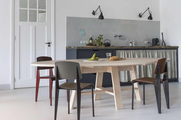 Interior designer Christen Starkenburg's Interieur-Plus workspace/curtained kitchen at Jan de Jong, a design shop in Friesland, the Netherlands | Remodelista