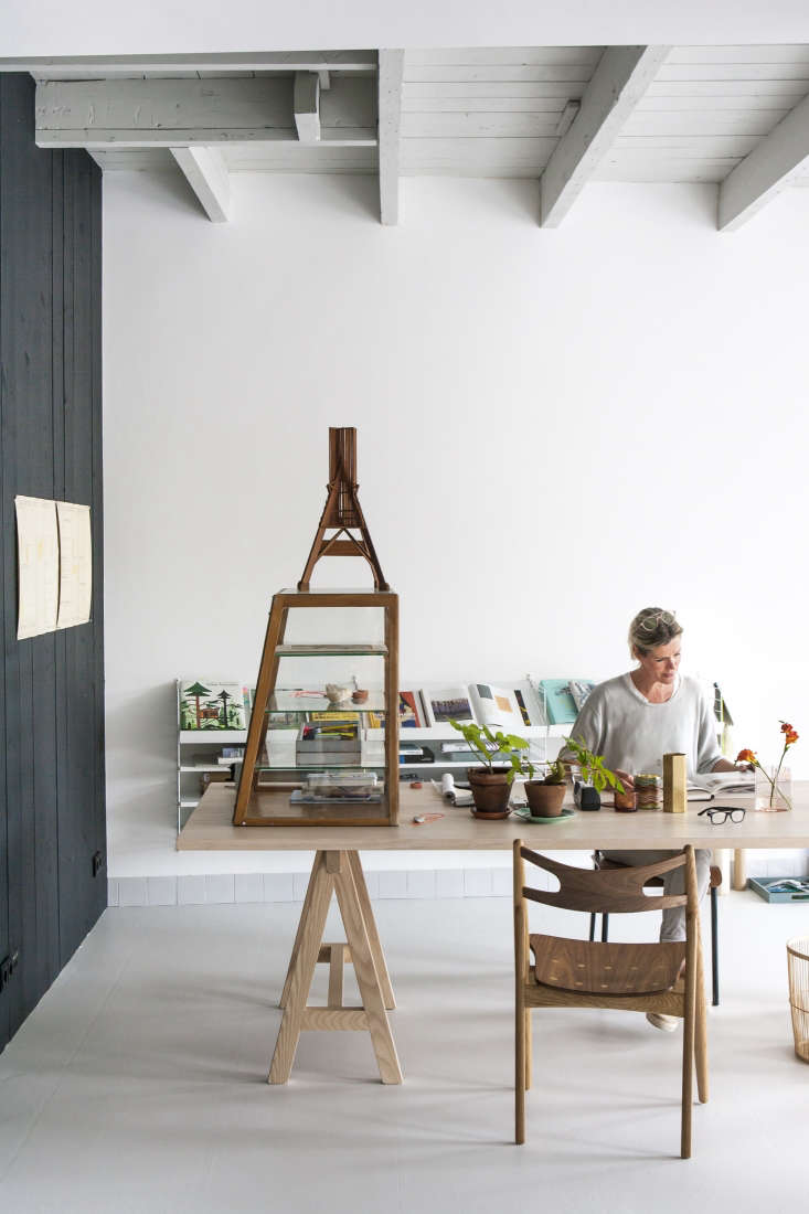 Dutch interior designer Christen Starkenburg of Interieur-Plus at work in her studio at Jan de Jong, her family's design shop in Friesland, the Netherlands | Remodelista