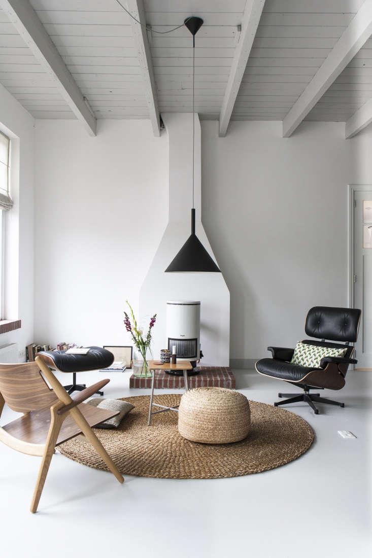 Scandi modern living area in the studio of Dutch interior designer Christen Starkenburg of Interieur-Plus at Jan de Jong, her family's design shop in Friesland, the Netherlands | Remodelista