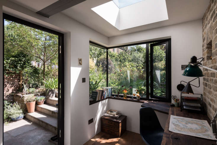 A stand-alone studio in the backyard may just be the holy grail of home offices. This one is particularly nice because of its views of and access to the garden. Photograph by French + Tye, courtesy of MW Architects, from A Light-Filled Writing Studio (plus Outdoor Shower) for a London Author.