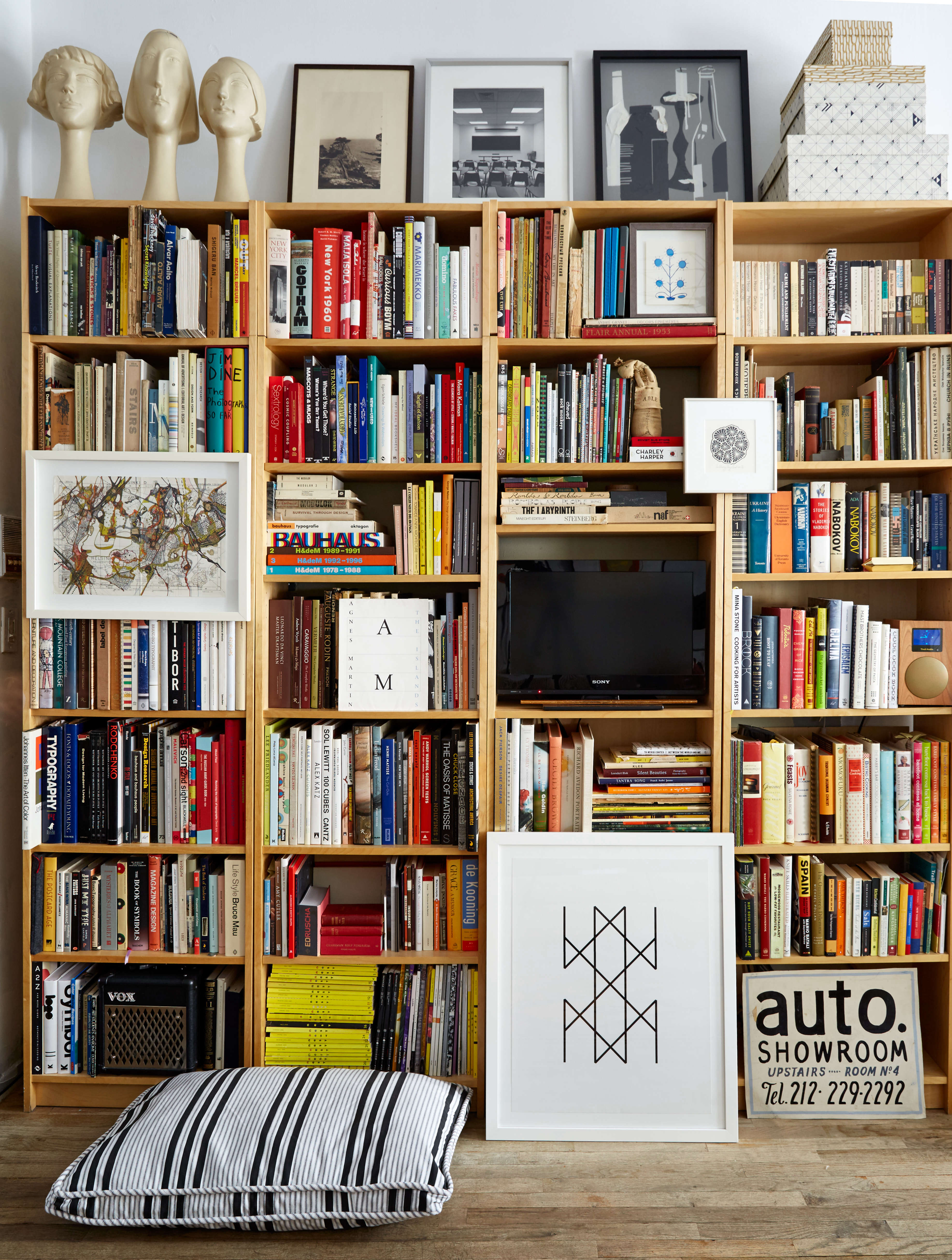 Wall-to-wall Ikea Billy bookshelves in Renata Bokalo and Roman Luba's NYC  apartment