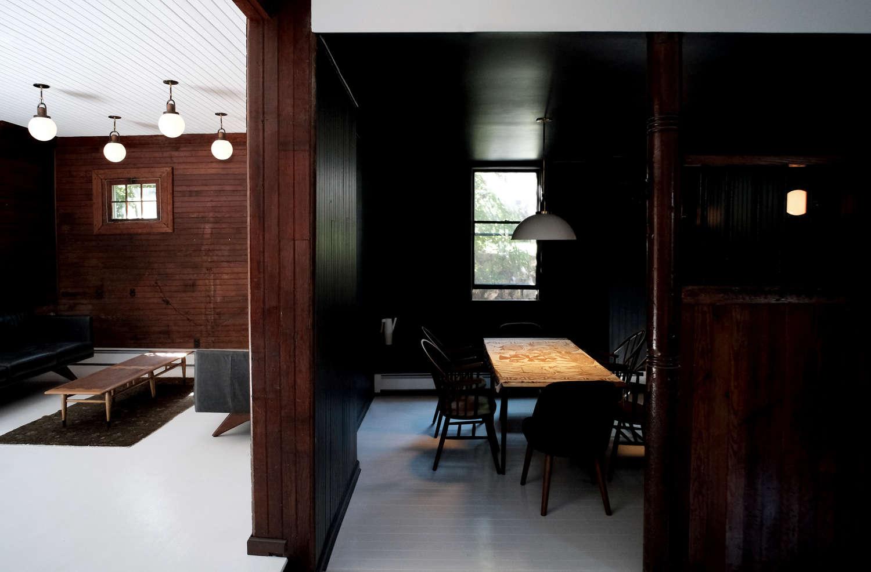 Dark-wood-paneling-on-walls-white-floor-space-exploration