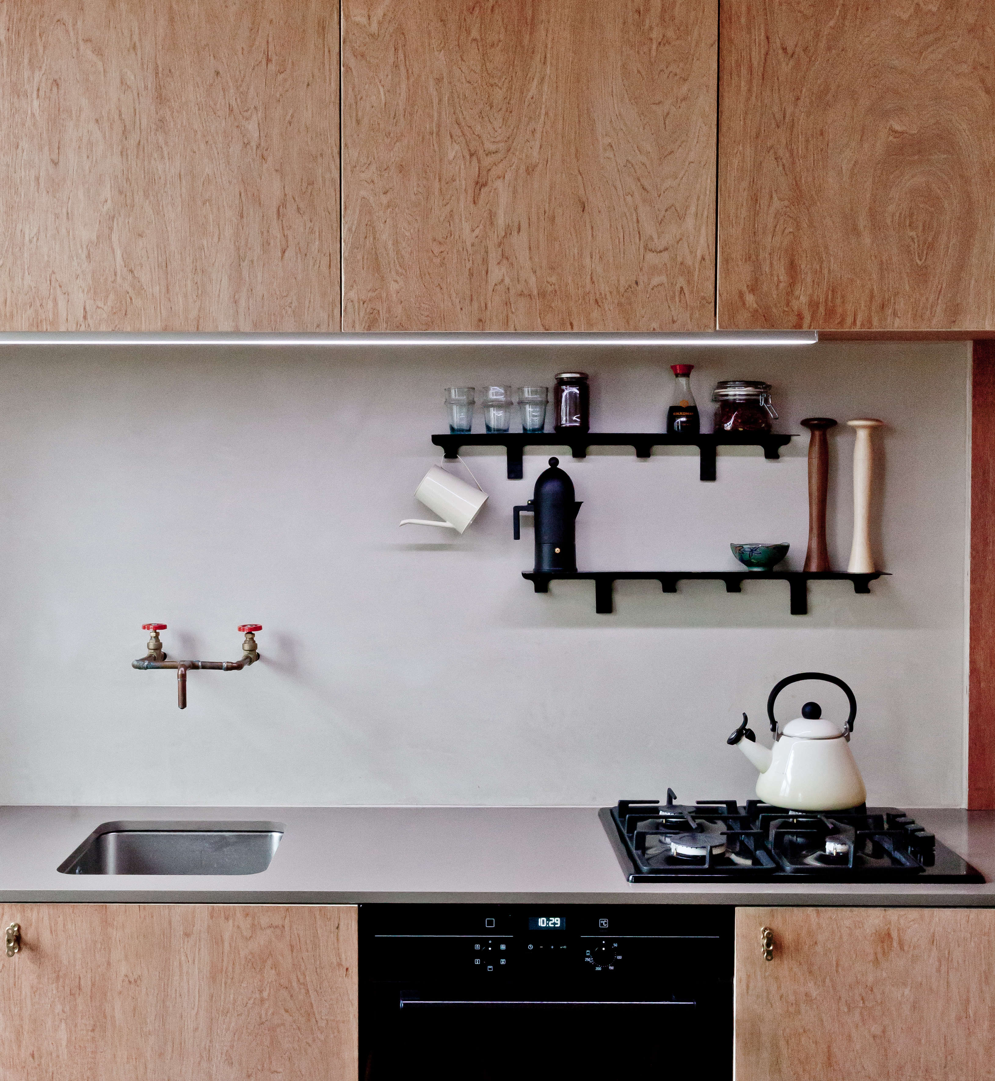 Solid plywood kitchen cabinets - Above The Kitchen Has A Solid Brushed Brass Faucet Fabricated From Piping And Other Plumber S Parts Sourced From Brass Electrical Accessories
