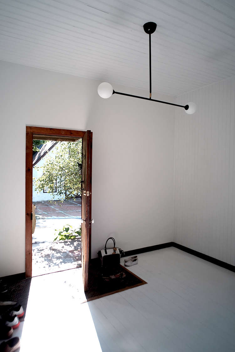 White-entryway-with-dark-wood-doorway-carriage-house-space-exploration