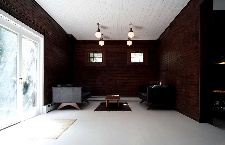 dark-paneled-living-room-white-ceiling-space-exploration