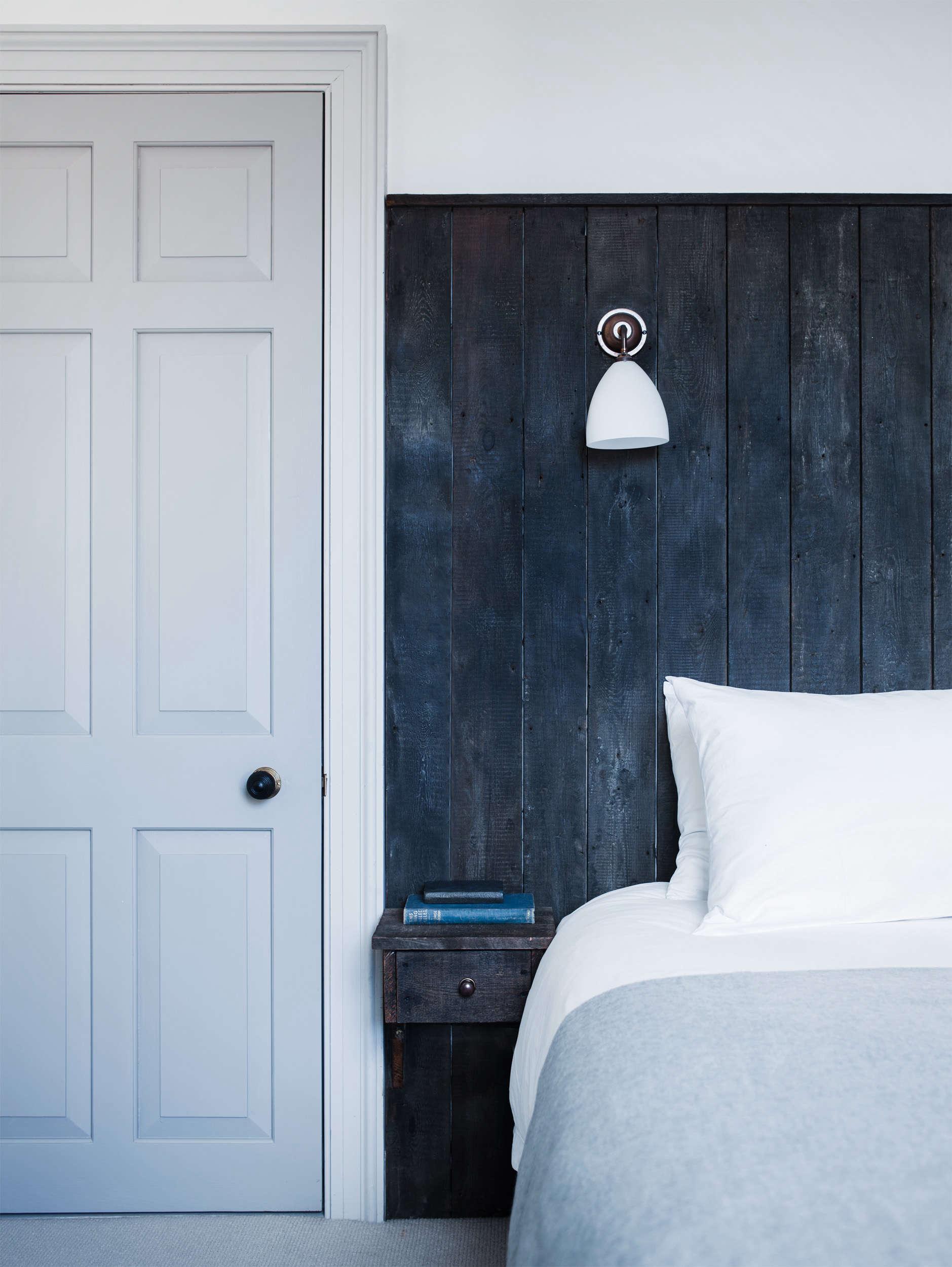 Dark Headboard in Blue Dorset House by Mark Lewis, Photo by Rory Gardiner