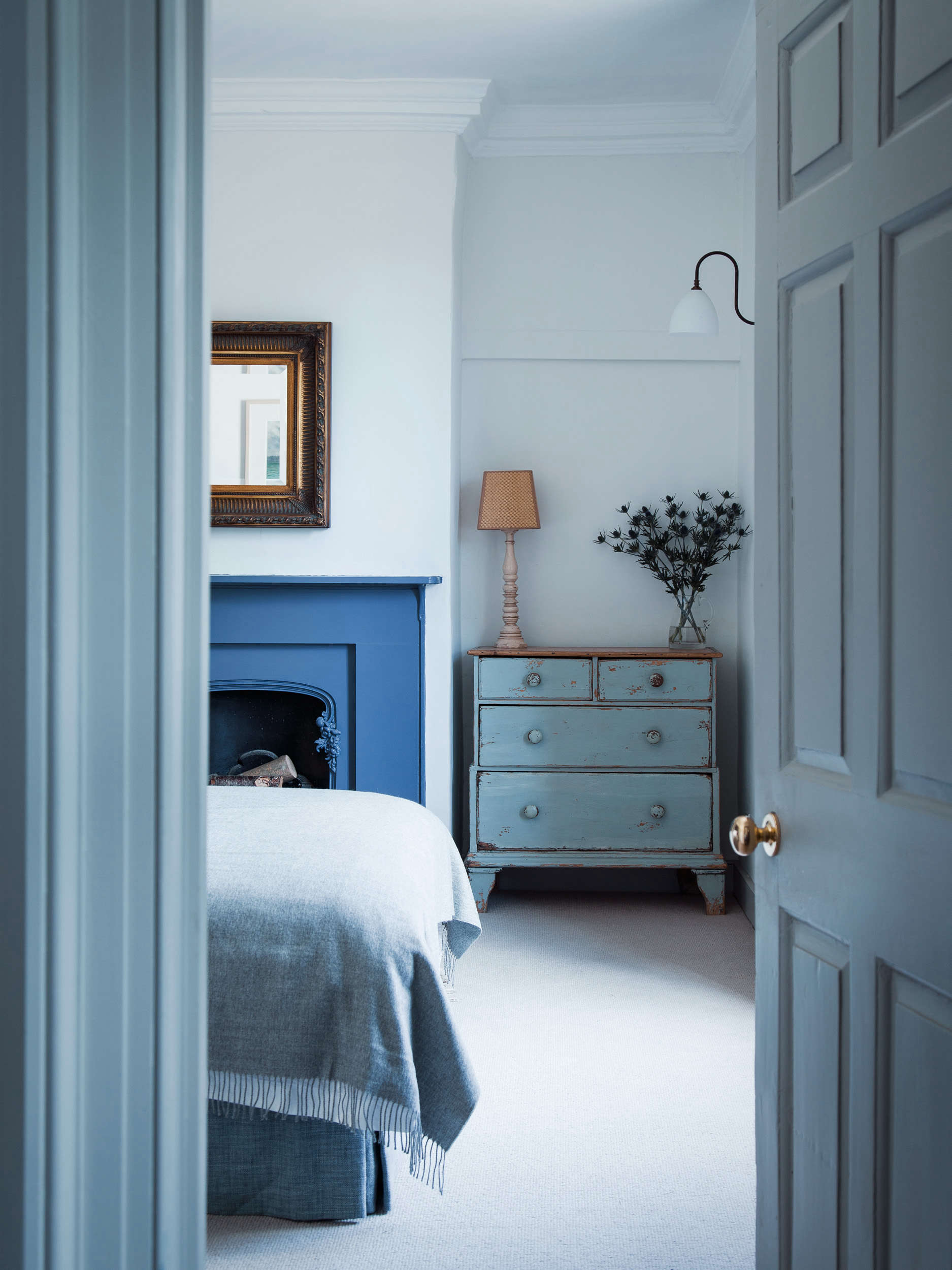 Bedroom with Blue Fireplace in Blue Dorset House by Mark Lewis, Photo by Rory Gardiner