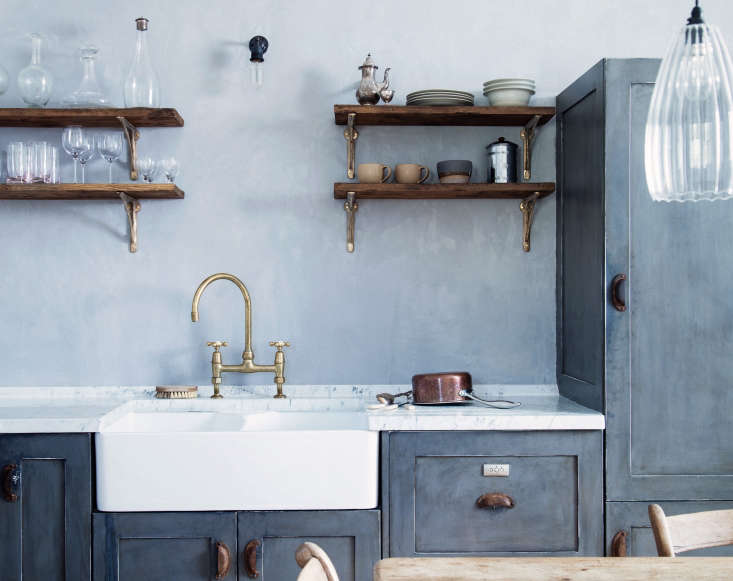 Costume designer turned interiors designer Mark Lewis uses double-bowl sinks in many of his London projects, which add to the old-time feel of his kitchens. See Blue Period: An English Manor House Channels Picasso for more. Photograph by Rory Gardiner.