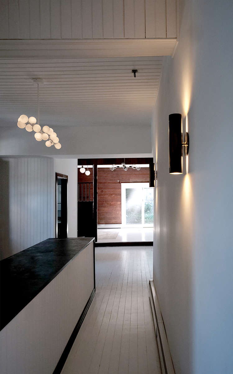 white-painted-walls-and-floors-carriage-house-space-exploration