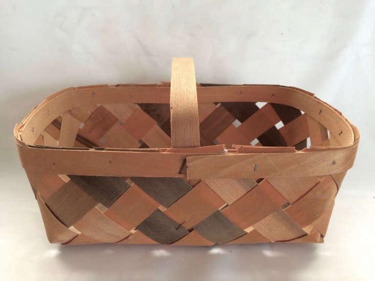 woven wooden harvest basket shaped like a trug