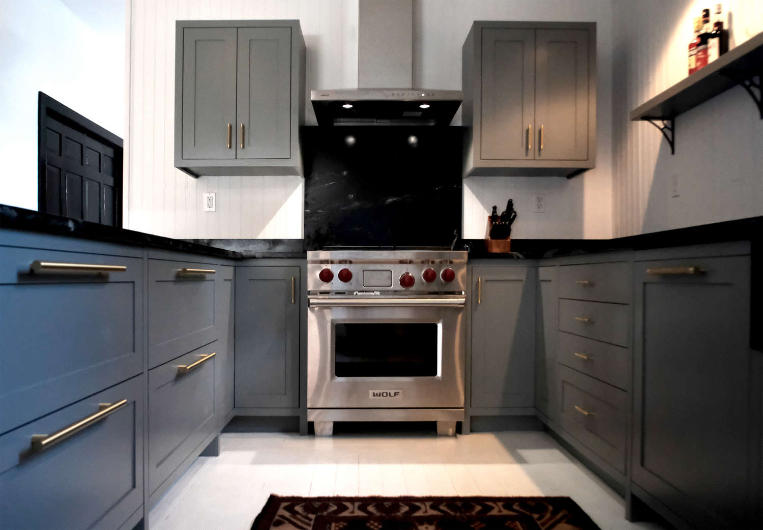 Before and after a tuxedo park carriage house gets an for Carriage house kitchen cabinets