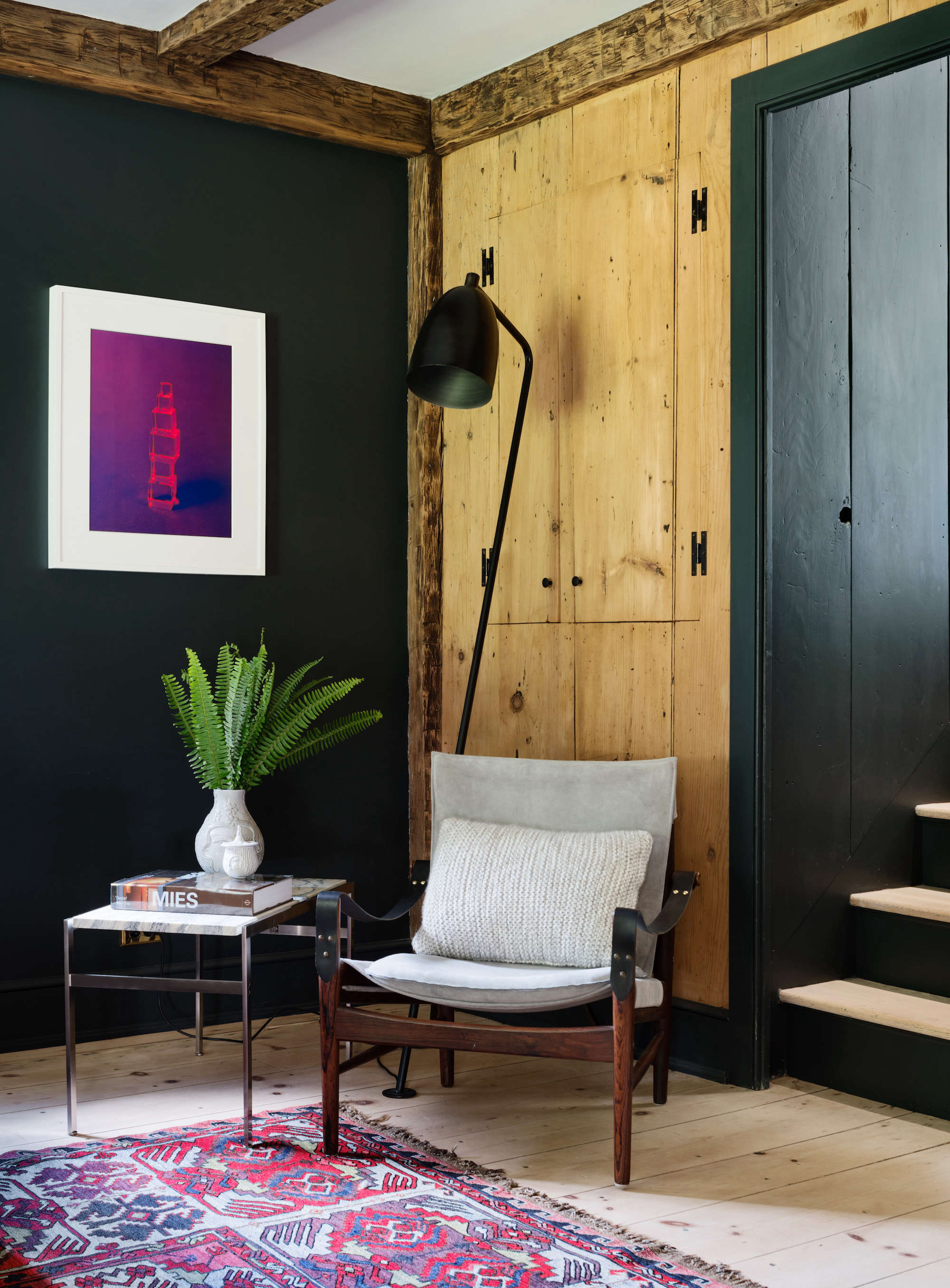 modern-farmhouse-renovation-with-wood-panel-walls-and-black-paint