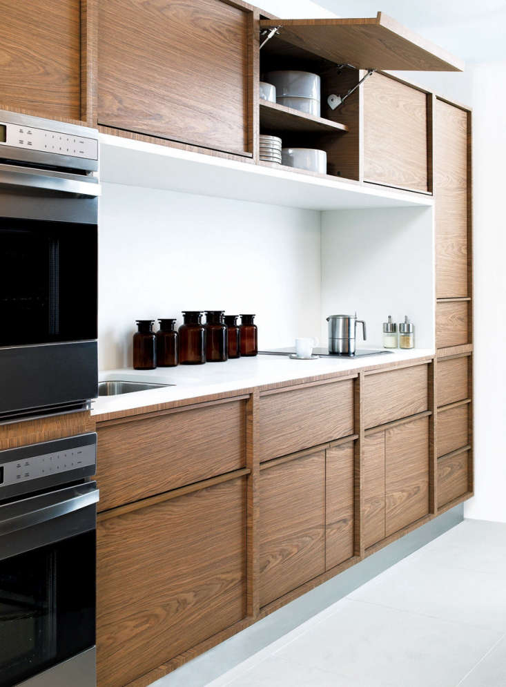 garage door hinges for upper cabinets allow for easy access in a kitchen by san 10