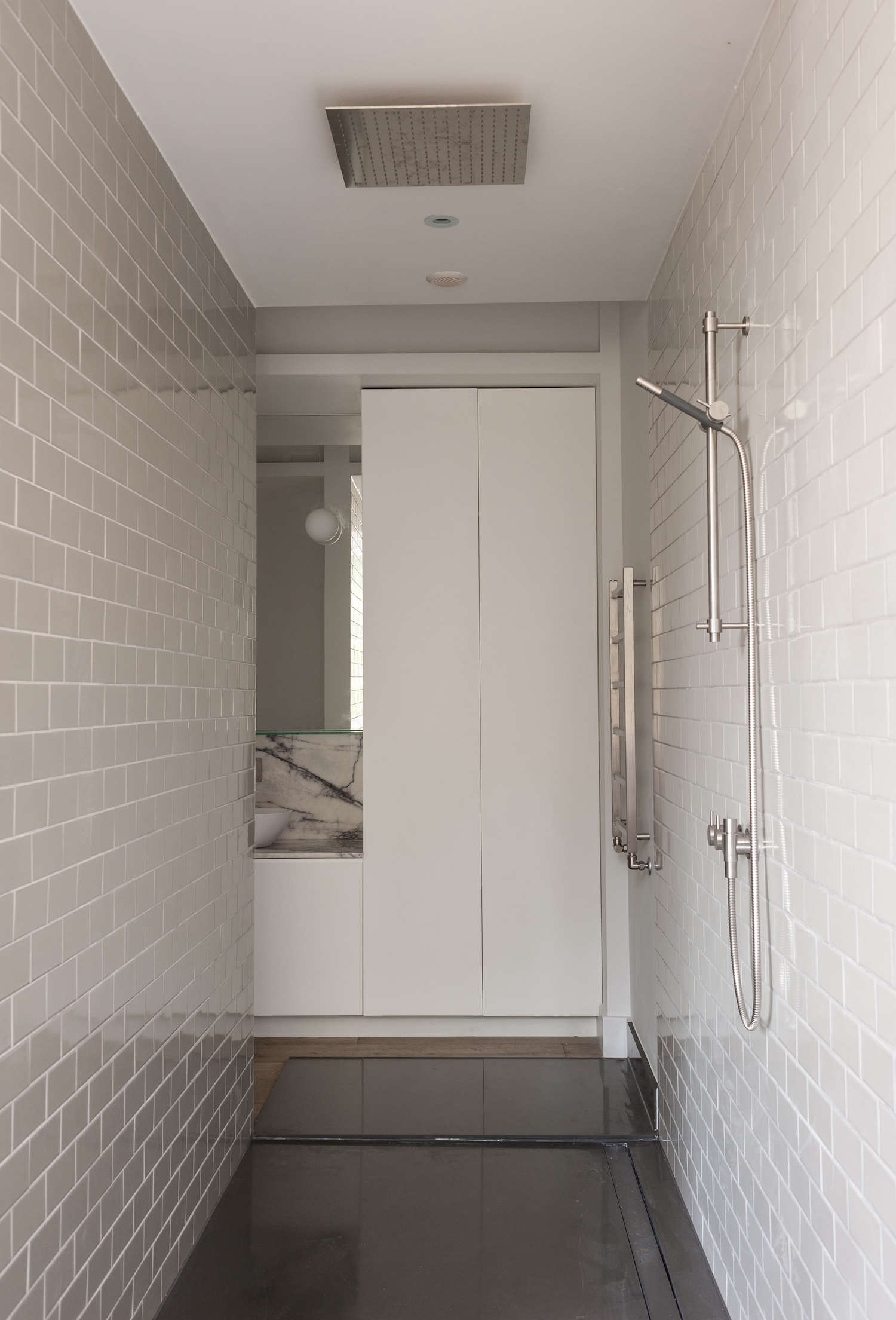 Bathroom of the week in london a dramatic turkish marble bathroom walk through shower with light gray subway ceramic tile dailygadgetfo Gallery