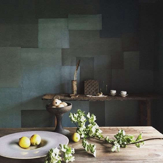 Green patchwork-patterned walls at Stardust, Kana Shimizu's boutique and cafe in Kyoto