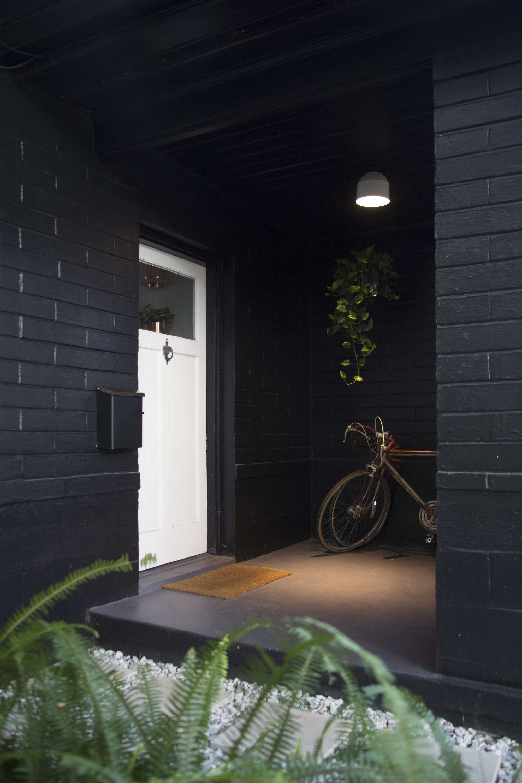 Browse the garden finished browse the garden before - Covered Entryway Florida Black Brick Painted House Bicycle