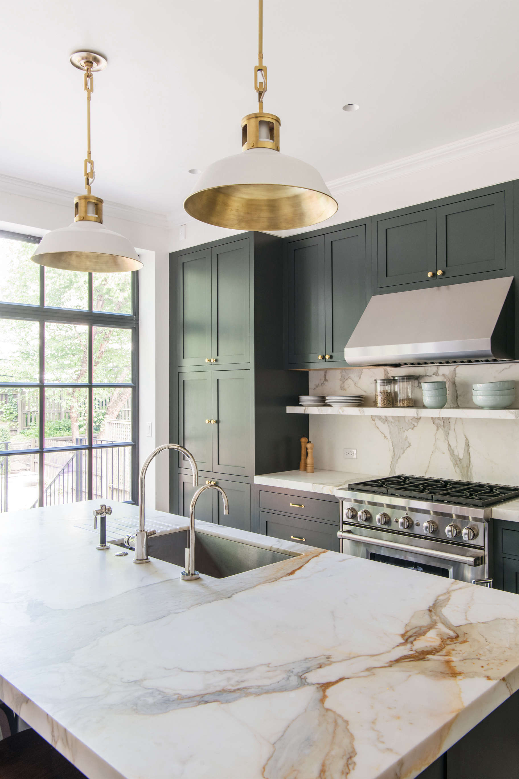kitchen-with-marble-countertop-pendant-lights-green-blue-cabinets-elizabeth-roberts