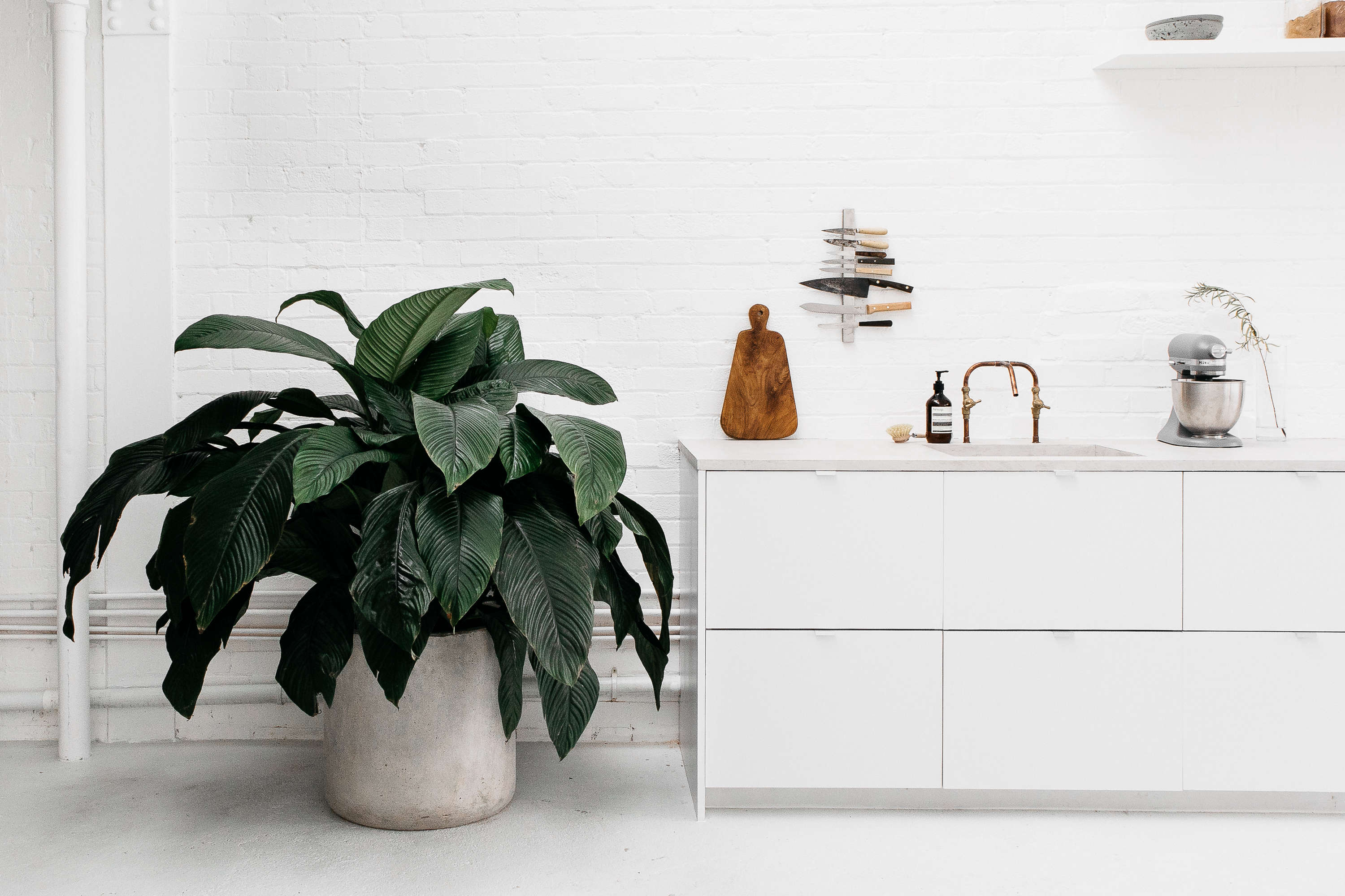 kitchen of the week an artful ikea hack kitchen by two london concrete planter copper diy kitchen faucet and vertical magnetic knife rack at rye london