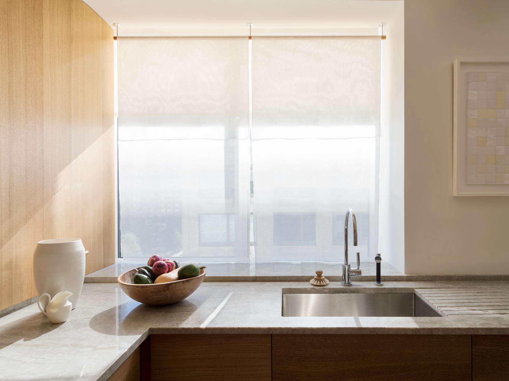 Translucent curtain panel woven by Japanese artist Hiroko Takeda in an NYC kitchen designed by Workstead