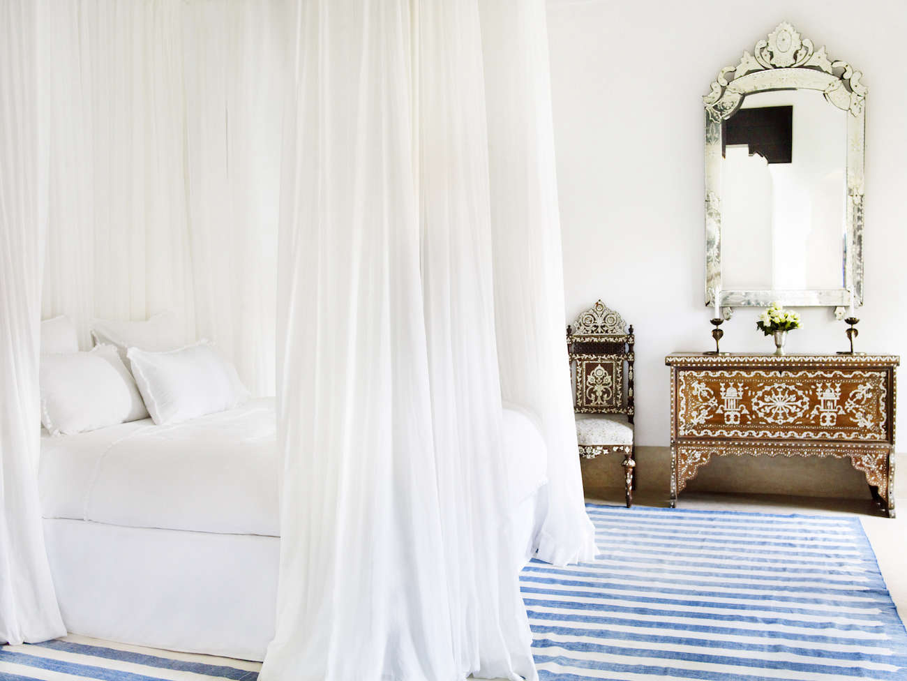 white-bed-curtains-blue-white-striped-rug-silver-mirror