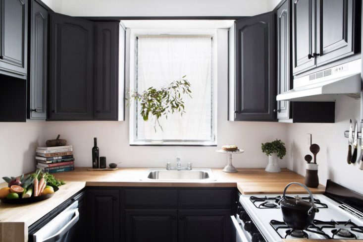 Designer Athena Claderone tackled her compact kitchen in Brooklyn with dark paint, Ikea countertops, and budget appliances. See more in Kitchen of the Week: A Low-Cost Before/After Kitchen in Brooklyn.