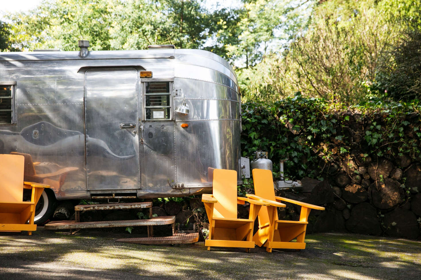 A large Airstream trailer serves as an office and check-in counter.