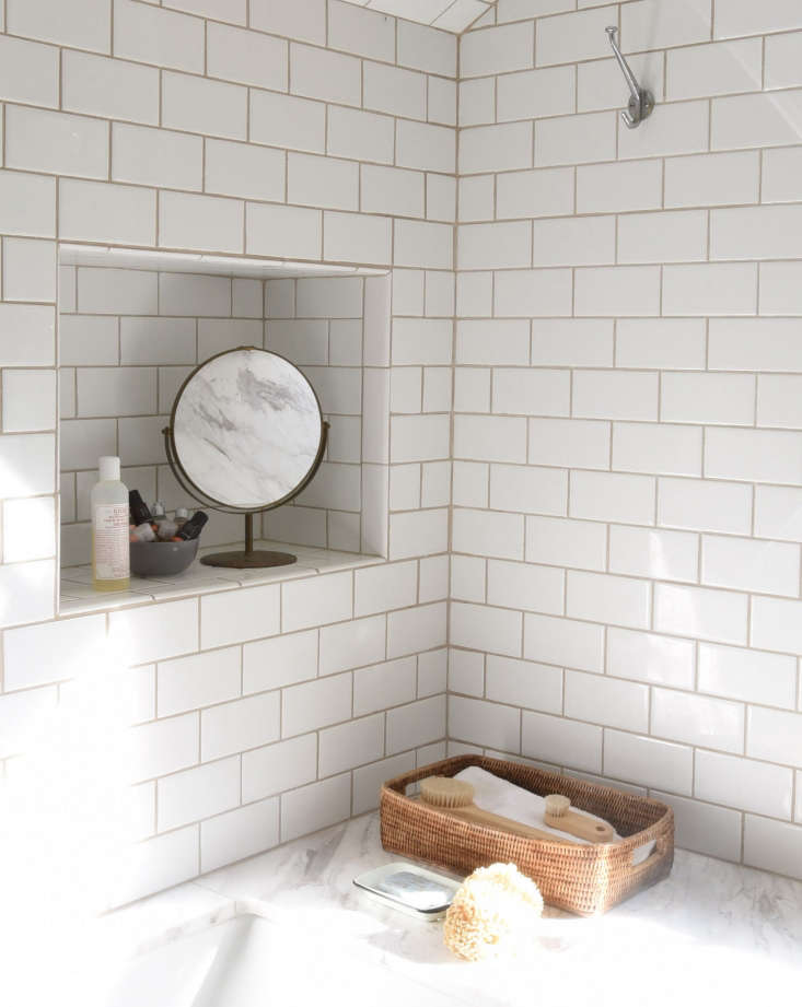 Built-in baths provide built-in storage; photography by Mylene Pionilla from Bathroom of the Week: A 1920s-Inspired Bathroom in a Renovated NY Farmhouse.