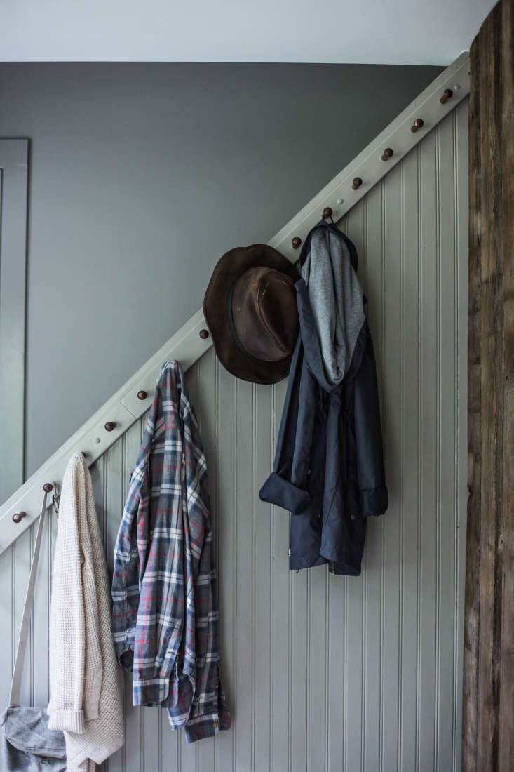 In a renovated New York farmhouse, Percy and Taratransformed a basic staircase into an architectural focal point(as well as a utilitarian coat rack) by installing beadboard paneling and simple Shaker hooks. (See: A Country House Reinvented by Jersey Ice Cream Co.) Photograph by Beth Kirby ofLocal Milk.