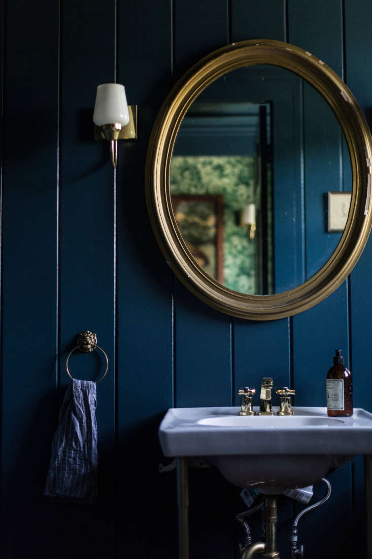 Painted a deep indigo, rustic V-groove suddenly takes on a more glamorous air.(See: A Country House Reinvented by Jersey Ice Cream Co.) Photograph by Beth Kirby ofLocal Milk.
