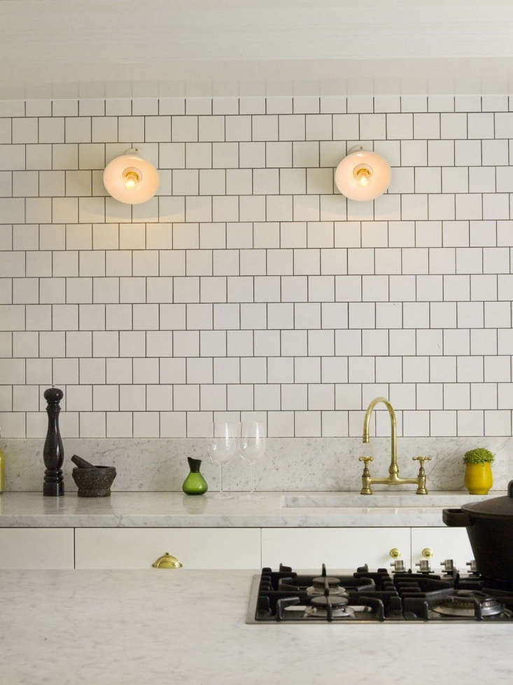 Honed marble counters pair with offset tile inDesigner Visit: Charles Mellersh in London.