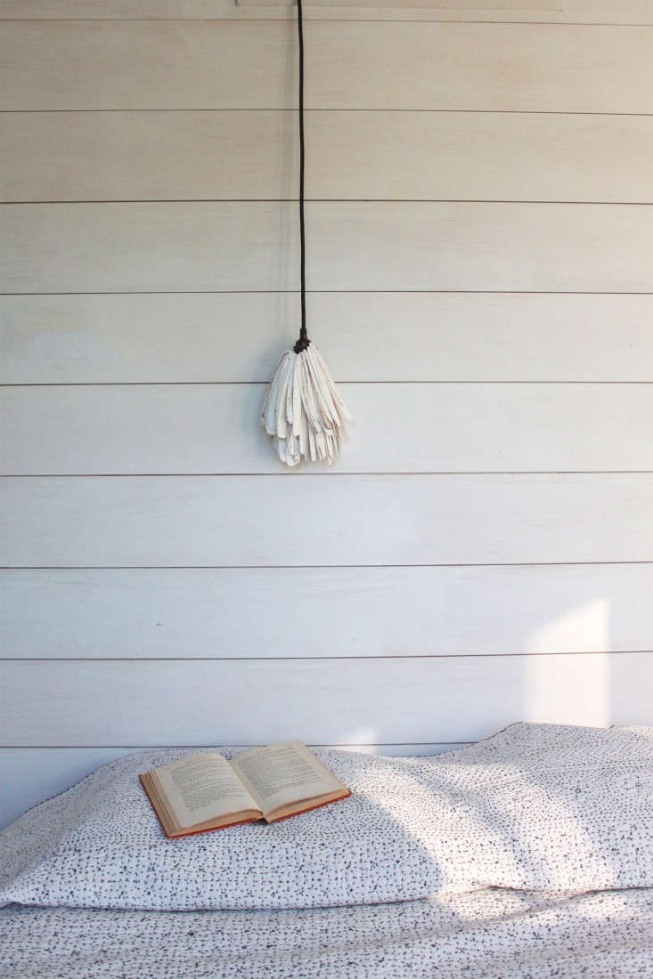A detail of shiplap in Sheila Bonnell's guest room shows the distinct gaps between the boards.