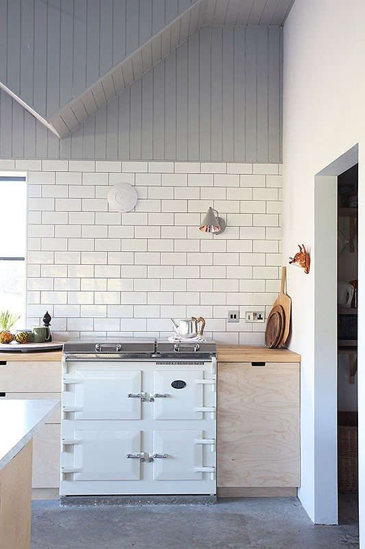 As seen in this updated farmhouse kitchen in Kent, thevisual simplicity of V-groove, lends itself to a contemporary setting where its rusticity can be employedto soften the space. (See:Kitchen of the Week: Eclectic English Kitchen, Color Included.)Photograph via Light Locations.