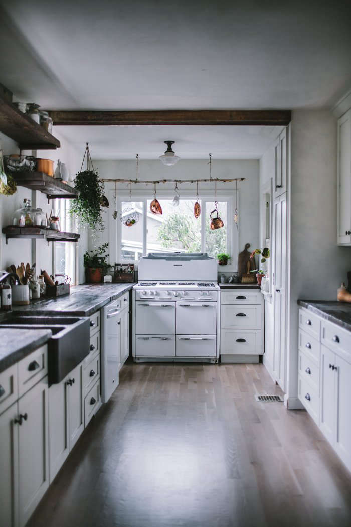 In remodeling her Portland, Oregon, kitchen, blogger Eva Kosmas Flores found a vintage 1950s Roper gas range on Craigslist for $375, and had the kitchen reconfigured with a gas line. Read more at A Food Blogger's Rustic DIY Renovation in Portland, OR, Dark and Moody Edition.