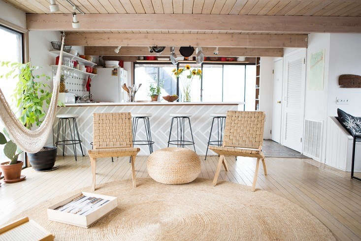 Natural fiber rugs, like this one in the houseboat home of Fredericks & Mae founders Gabe Cohen and Jolie Signorile, not only reflect the casual vibe of the coast but also are excellent sand traps. See Rehab Diary: The Ultimate Houseboat in NYC. Photograph by Douglas Lyle Thompson.