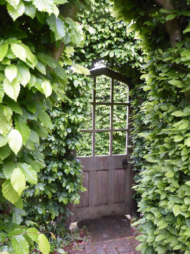 Long Barn Vita Sackville West hornbeams hedge garden door by Clare Coulson