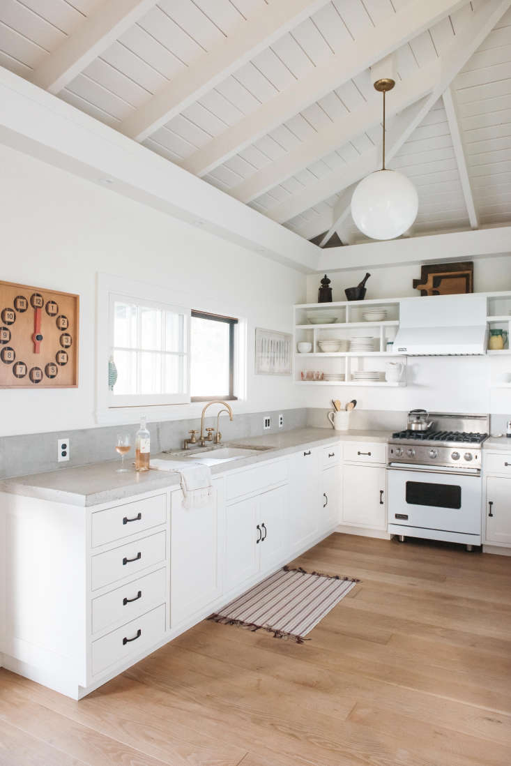 A Viking range fits with the white color scheme in A Vintage Hawaiian Cottage Restored (with Its Own Instagram Account).