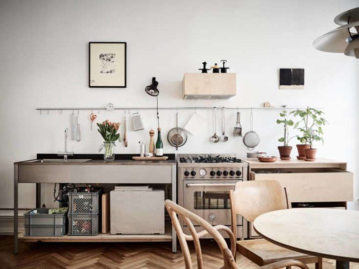 A freestanding range sits between freestanding counter units in Steal This Look: Smart Storage in a Swedish Kitchen.