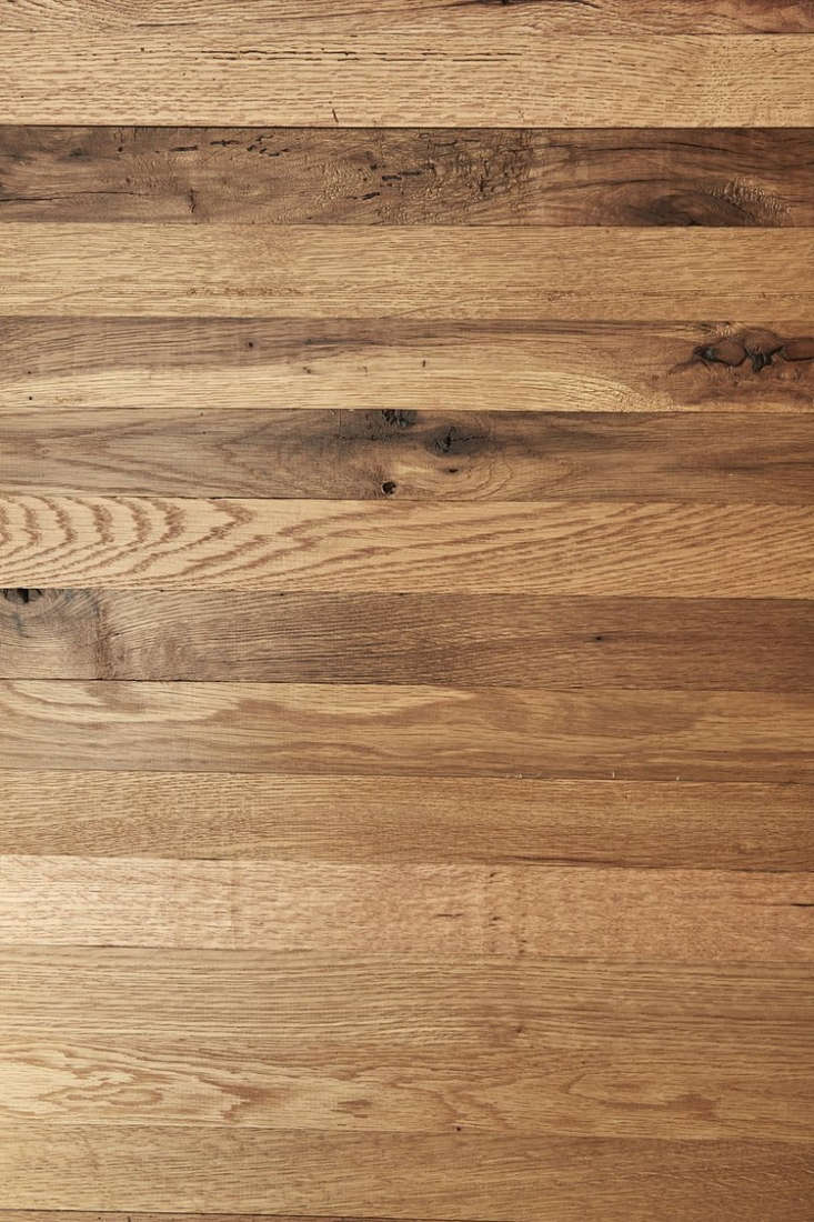 A detail of the Reclaimed New Face Oak flooring used in the bedroom shown above.