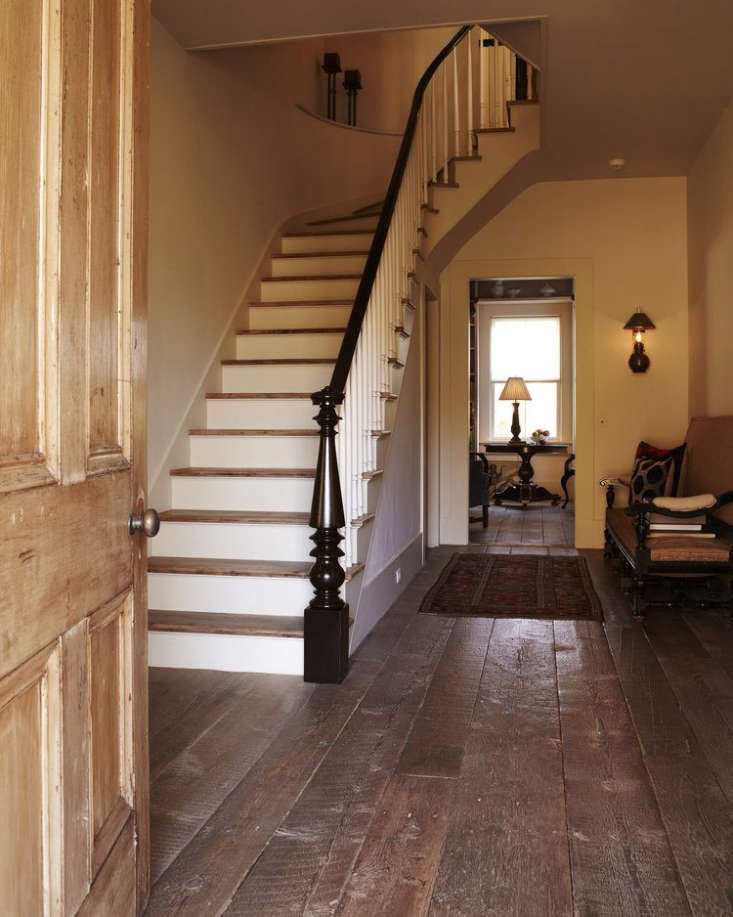 The entryway of a Vermont farmhouse with Reclaimed Mixed Softwoods in a natural finish.