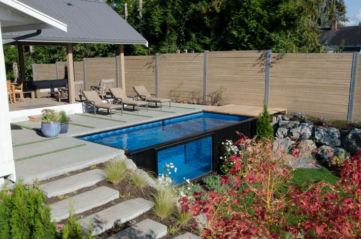 Shipping containers 10 recycled and repurposed houses for Repurposed swimming pool