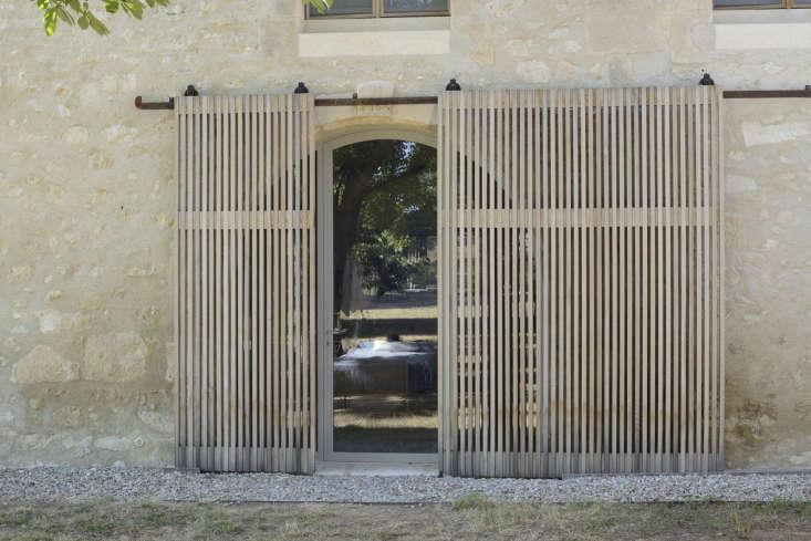 Sliding slatted doors, LSL Architects' refurbished 18th century farmhouse Les Baux de Provence. Katrin Vierkant photo.