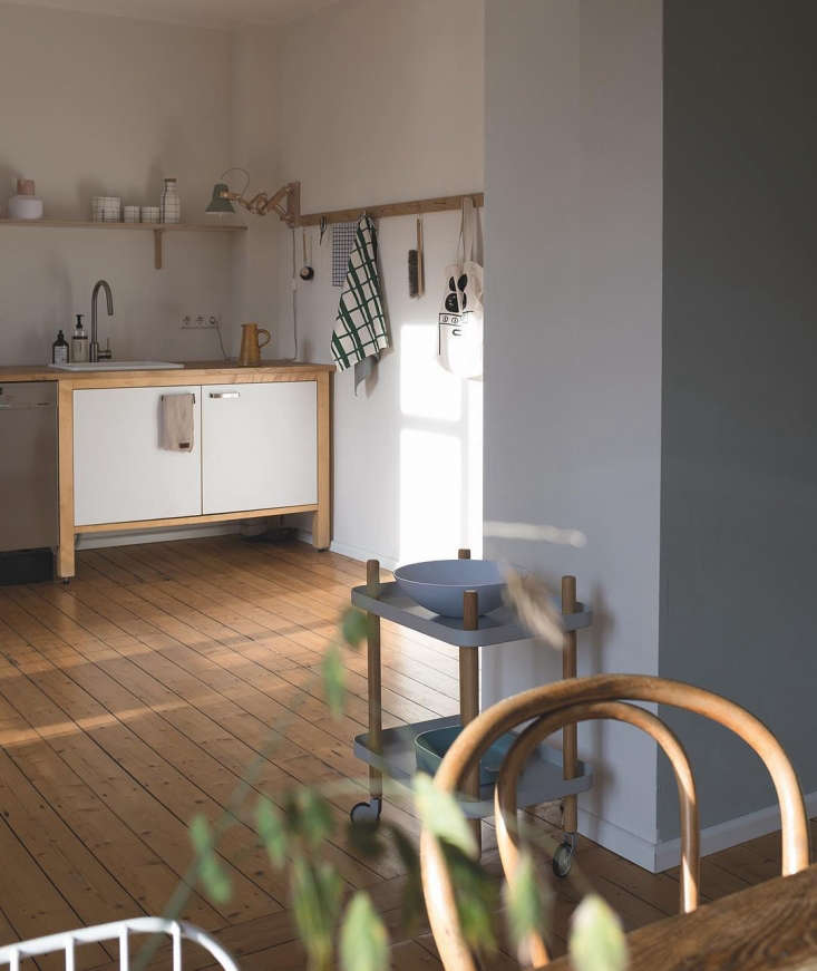 Repurposed Ikea Varde kitchen and Norm Copenhagen cart in the home of Swantje Hinrichsen, Munster, Germany.