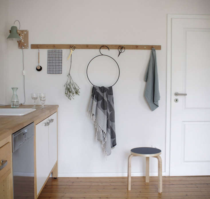 Shaker peg rail used for hanging accessories in the kitchen of Swantje Hinrichsen, Munster, Germany.